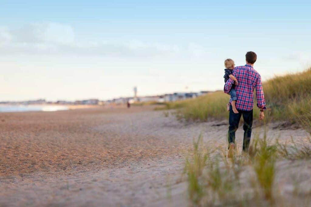 man and son on beach